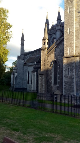 Christ Church had buttresses; St. Patrick's has flying buttresses.